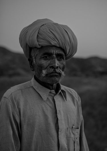 Black and White Photography with the title 'India 8'. Portrait of an Indian man with a turban.