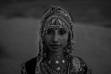 Black and white photography with the title 'India 16'. Portrait of a young Indian woman in a traditional Costume.