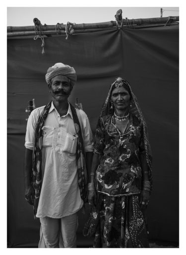 india 18 - black and white portrait of a traditionally dressed indian woman and man - by Will Falize - friendmade.fm